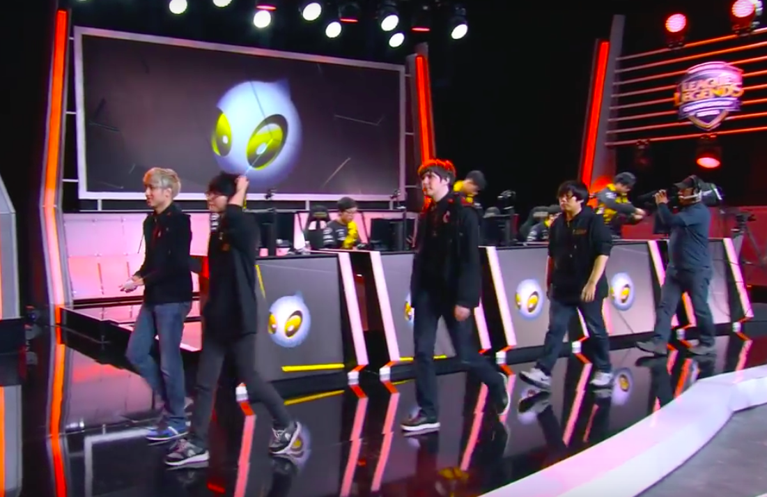 Team Dragon Knights cross the stage after beating Dignitas. Image via Youtube